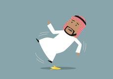 Arabian businessman slipped on a banana peel. Arabian businessman in national costume slipped on a banana peel and falling down, waving hands in the air Royalty Free Stock Photos