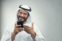 Arabian Businessman smiling on the phone. Posing against a great background Royalty Free Stock Images