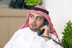 Arabian Businessman talking on phone Stock Photography