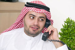 Arabian Businessman talking on phone Stock Photos