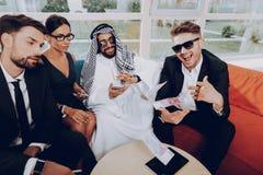 Arabian Businessman Throwing Banknotes In The Air.