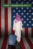 Arabian businessman with USA flag and Trump policy Royalty Free Stock Image