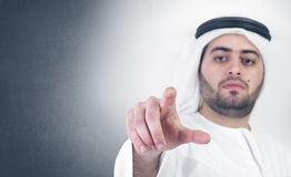 Arabian businessman in a virtual click scene Royalty Free Stock Image