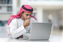 Arabian businessman working in his office Stock Photos