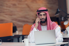 Arabian businessman working in modern startup office Stock Photos