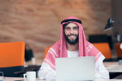 Arabian businessman working in modern startup office Royalty Free Stock Images