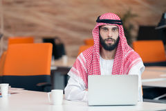 Arabian businessman working in modern startup office Stock Photography