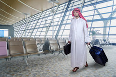 Arabian businessperson walks in airport Stock Photography