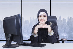 Arabian businesswoman daydreaming with a computer Royalty Free Stock Photography