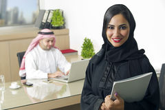 Arabian Businesswoman with her boss on Background Stock Photos
