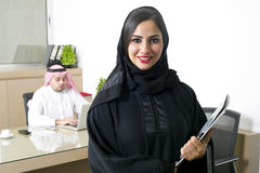 Arabian Businesswoman with her boss on Background Royalty Free Stock Images