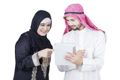 Arabian businesswoman pointing on digital tablet Stock Photography