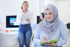 Arabian Businesswoman in startup office with team working in the background, royalty free stock images