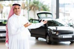 Arabian car salesman Stock Images