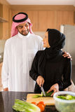 Arabian couple cooking royalty free stock images