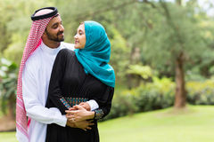 Arabian couple embracing. Lovely arabian couple embracing outdoors Stock Photos