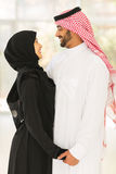 Arabian couple hugging home Royalty Free Stock Photos