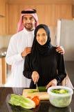 Arabian couple kitchen royalty free stock photos