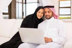Arabian couple laptop home Stock Image