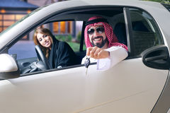 Arabian couple in a newely purchased car.  Stock Images