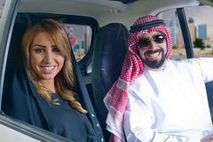 Arabian couple in a newely purchased car Stock Photo