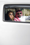 Arabian couple in a newely purchased car.  Royalty Free Stock Images