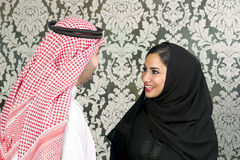 Arabian couple posing. Against a decorated background Stock Images