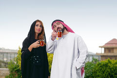 Arabian couple relaxing & drinking tea Royalty Free Stock Images