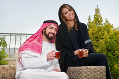 Arabian couple relaxing & drinking tea Royalty Free Stock Photography