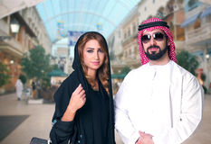 Arabian Couple Shopping in the mall Royalty Free Stock Photo