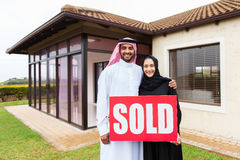 arabian couple sold sign royalty free stock image