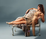 Arabian dancer relax on  old-styled chair Stock Photography