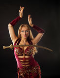 Arabian dancer with saber on breast Royalty Free Stock Photo