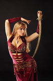 Arabian dancer with saber on hip Stock Photo