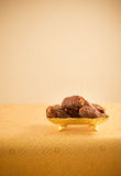Arabian dates in golden plate Stock Photography