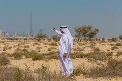 Arabian desert. Arab in the Arabian desert on a hot sunny day royalty free stock photography