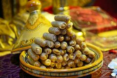 Arabian dessert sweets traditional culture. The nuts wrapped in dough are also watered with syrup royalty free stock image