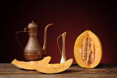 Arabian dishes and fresh melon Royalty Free Stock Image