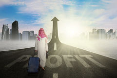 Arabian entrepreneur with a profit word on the road Stock Image