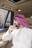 Arabian entrepreneur thinking idea in car Royalty Free Stock Image