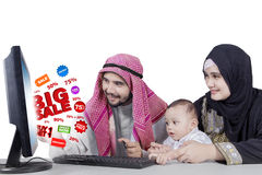 Arabian family with big sale on monitor Stock Images