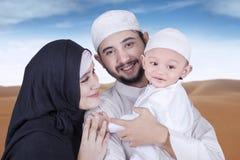 Arabian family at desert smiling on the camera Royalty Free Stock Photos
