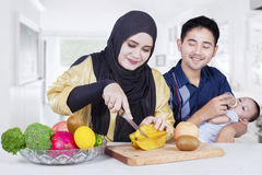 Arabian family with fruits in dining room Royalty Free Stock Image