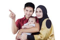 Arabian family looking something in studio Royalty Free Stock Photo