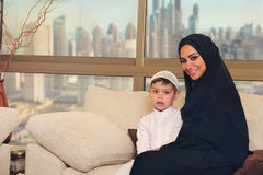 Arabian family, mother and son sitting on the couch in their living room Stock Image