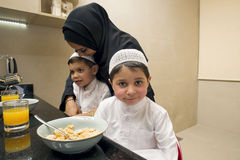 Arabian family of Mother and Two kids having Breakfast in the morning Royalty Free Stock Images