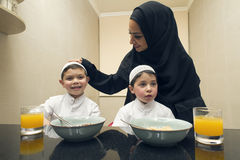 Arabian family of Mother and Two kids having Breakfast in the morning Stock Photo