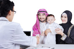 Arabian family with pediatrician in the studio Royalty Free Stock Photography