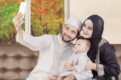 Arabian family taking selfie photo with autumn royalty free stock images