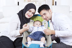 Arabian family with their son in stroller Royalty Free Stock Images